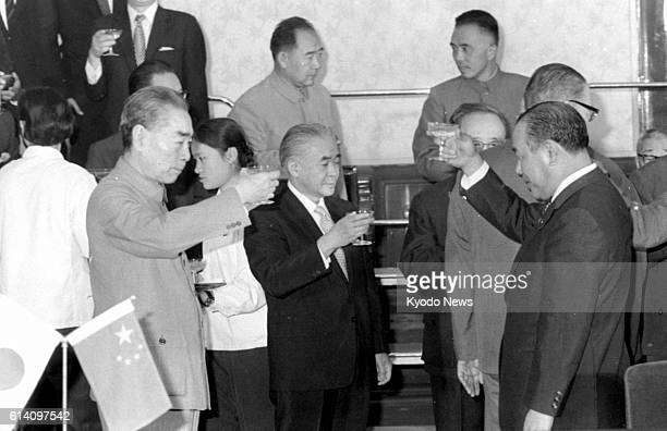 TOKYO Japan File photo taken Sept 29 shows Japanese Prime Minister Kakuei Tanaka and Chinese Premier Zhou Enlai raising glasses in a toast after the...