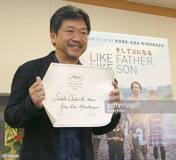 NARITA Japan Film director Hirokazu Koreeda holds a certificate of the Prix du Jury of the 2013 Cannes International Film Festival during a press...