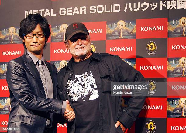 TOKYO Japan Film producer Avi Arad and Hideo Kojima a corporate officer of Konami Digital Entertainment Co shake hands in Tokyo on Aug 30 after...