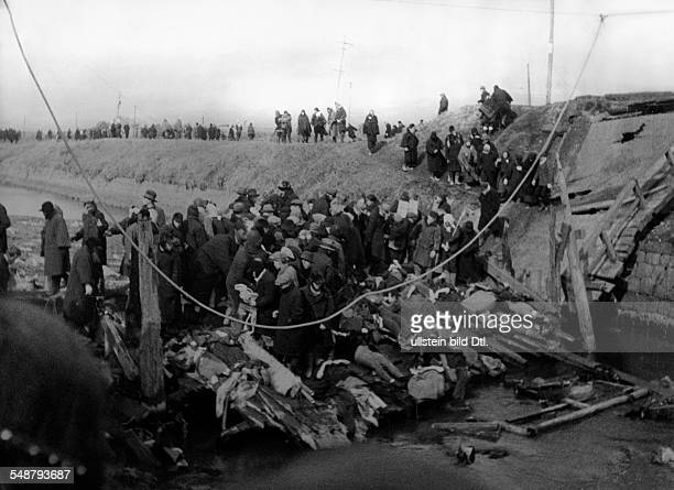 Japan Fire disaster in the port city of Hakodate a wooden bridge collapses under the weight of the people trying to escape the fire 1934 Vintage...