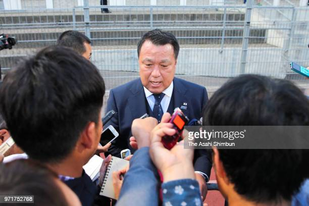 Japan Football Association President Kozo Tashima speaks to media reporters after his side's 02 defeat in the international friendly match between...