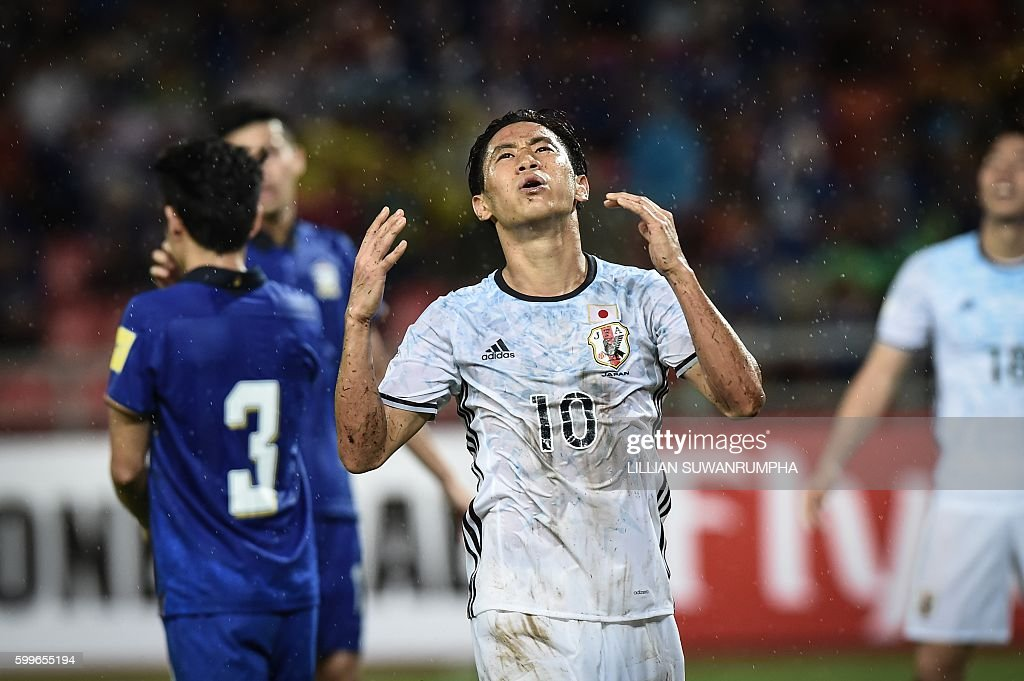 Japan football player Shinji Kagawa reacts after a failed attempt on goal during the 2018 World Cup qualifying football match between Thailand and Japan in Bangkok on September 6, 2016. / AFP / LILLIAN