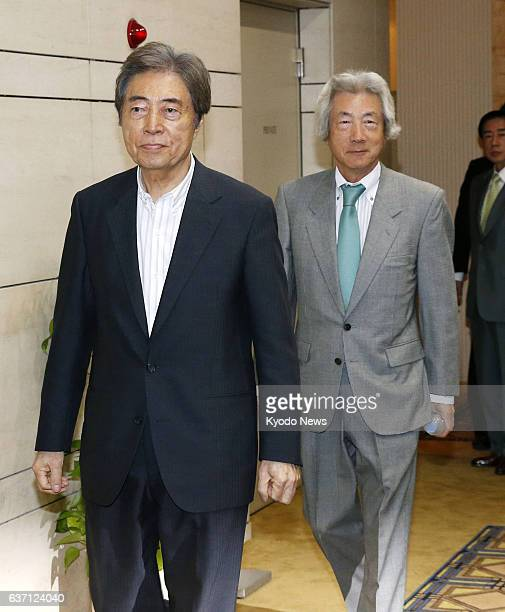 TOKYO Japan Former Japanese prime ministers Morihiro Hosokawa and Junichiro Koizumi head for a meeting to launch the Japan Assembly for Nuclear Free...