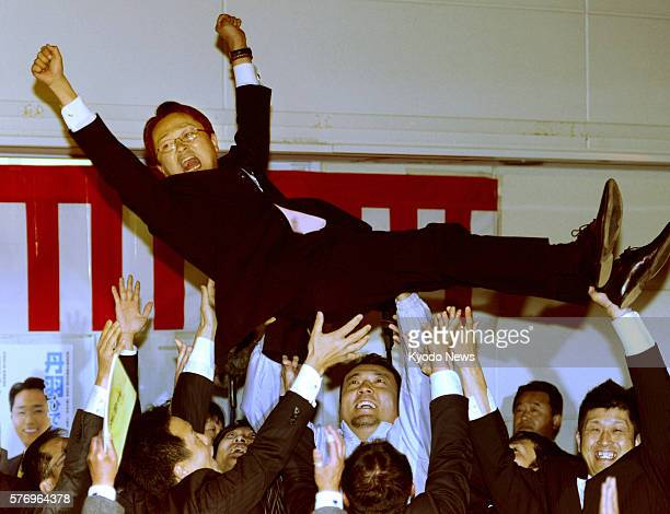 KASUGAI Japan Former Liberal Democratic Party lower house member Hideki Niwa is tossed in the air in Kasugai Aichi Prefecture after his victory is...