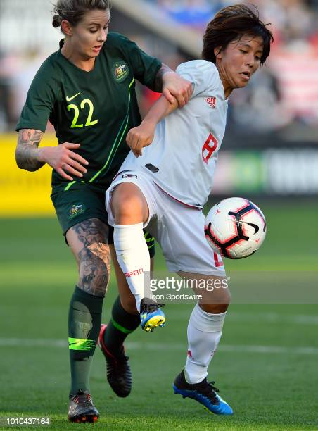 Japan forward Mana Iwabuchi shields Australia defender Larissa Crummer from the ball during the 2018 Tournament Of Nations at Toyota Park on August 2...