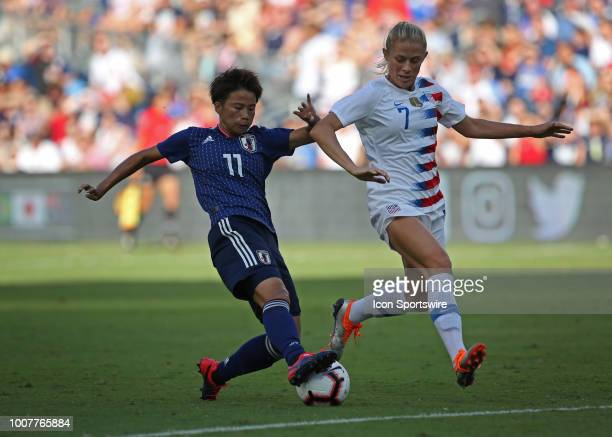 Japan forward Mina Iwabuchi makes a move past USA defender Abby Dahlkemper to set up her goal in the first half of a women's soccer match between...