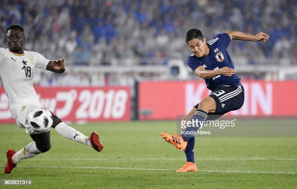 Japan forward Muto Yoshinori shoots past Andrew KyereYiadom of Ghana during the second half of a friendly match at Nissan Stadium in Yokohama on May...