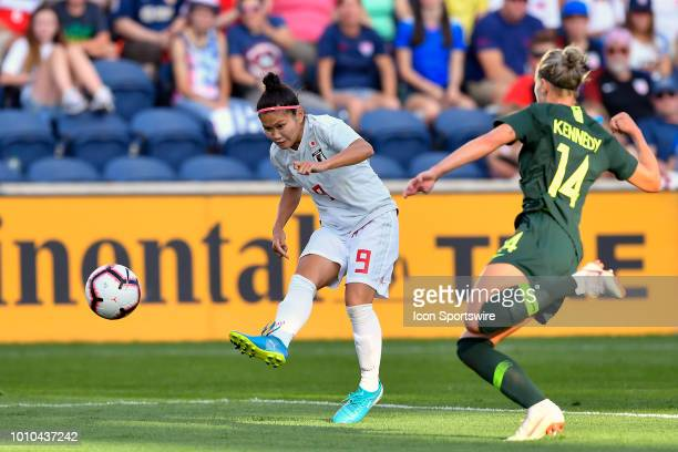 Japan forward Nahomi Kawasumi shoots against Australia defender Alanna Kennedy during the 2018 Tournament Of Nations between Australia and Japan at...