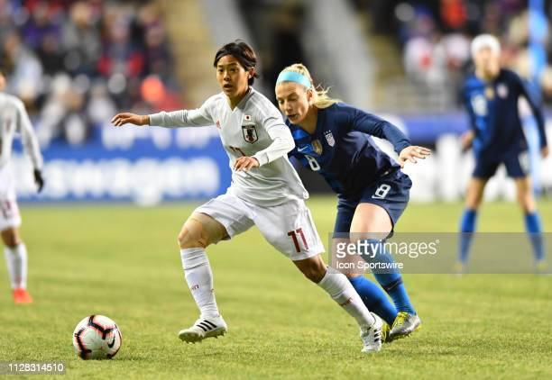 Japan Forward Rikaka Kobayashi keeps the ball from US Midfielder Julie Ertz in the first half during the She Believes Cup game between Japan and the...