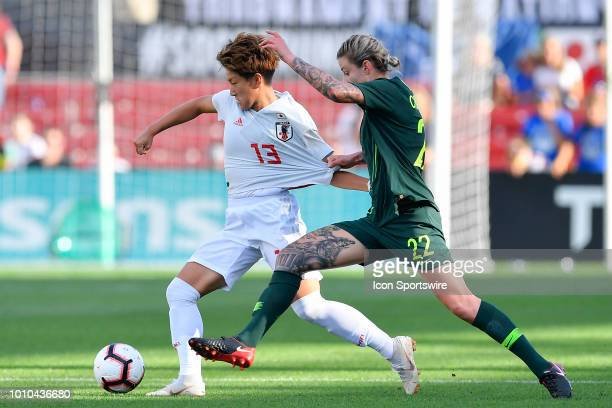 Japan forward Yuika Sugasawa is grabbed by Australia defender Larissa Crummer during the 2018 Tournament Of Nations at Toyota Park on August 2 2018...