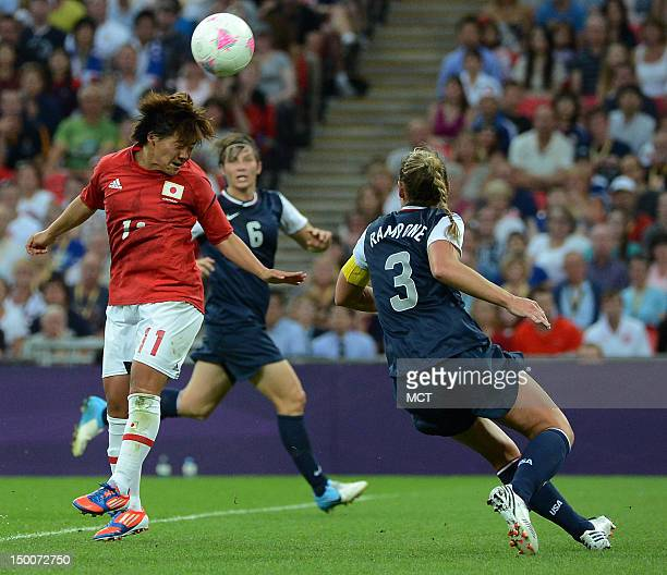 Japan foward Shinobu Ohno heads a shot on goal past USA defender Kelley O'Hara during the first half of the Olympics women's soccer gold medal match...