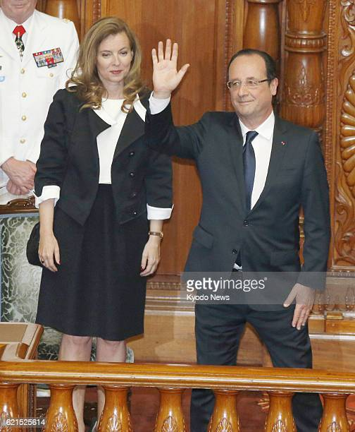 TOKYO Japan French President Francois Hollande accompanied by his partner Valerie Trierweiler waves as Japanese lawmakers applaud following his...
