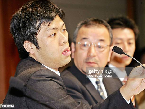 Fumito Kumagai new representative of Japan's Internet firm Livedoor speaks to the press while newly appointed President Kozo Hiramatsu looks on at a...
