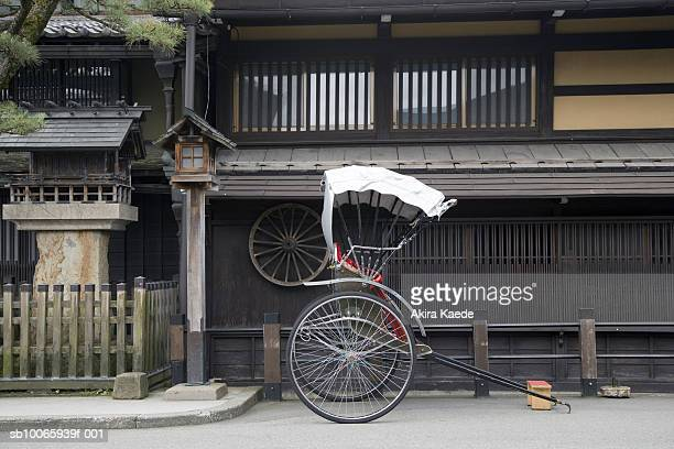 japan, gifu, takayama city, rickshaw in street - takayama city stock pictures, royalty-free photos & images
