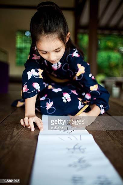 Japan girl writing kanji