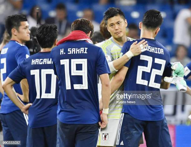 Japan goalkeeper Eiji Kawashima consoles teammates after Japan lost to Belgium 32 in a World Cup roundof16 match in RostovOnDon Russia on July 2 2018...