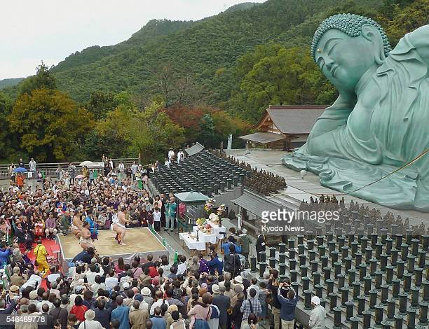 SASAGURI Japan Grand sumo champion Hakuho performs a dedicatory ring entering ceremony in front of a huge bronze statue of a reclining Buddha 41...