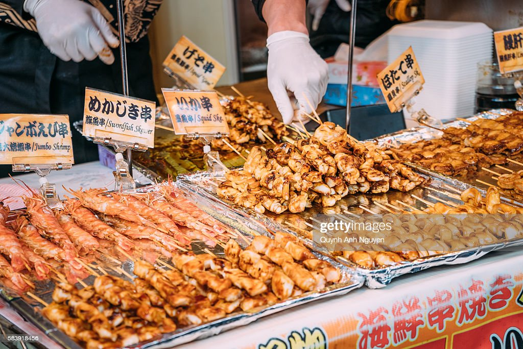 Japan Grilled Seafood For Sale At Tsukiji Market In Tokyo Stock