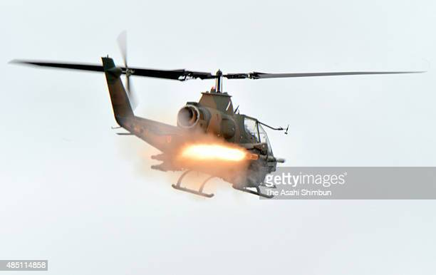A Japan Ground SelfDefence Force's AH1S 'Cobra' helicopter fires a missile during the annual live firing exercise at the JGSDF's East Fuji Maneuver...