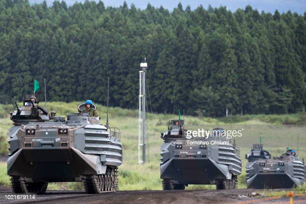 Japan Ground SelfDefense Force amphibious assault vehicles move during a live fire exercise at the foot of Mount Fuji in the Hataoka district of the...