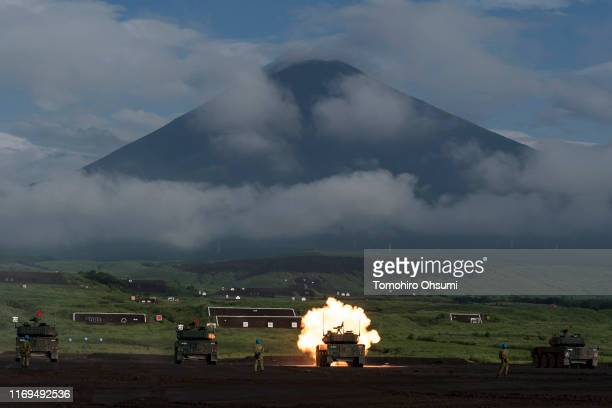 Japan Ground SelfDefense Force battle tank fires ammunition during a live fire exercise at the foot of Mount Fuji in the Hataoka district of the East...