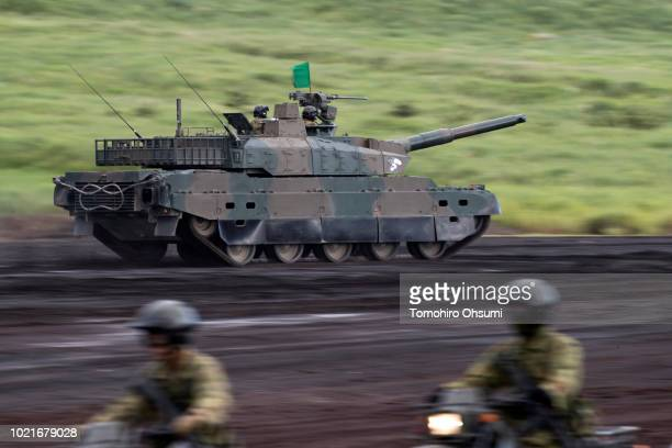 Japan Ground SelfDefense Force battle tank moves during a live fire exercise at the foot of Mount Fuji in the Hataoka district of the East Fuji...