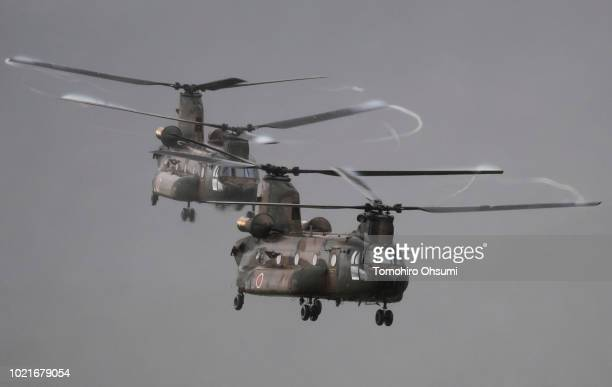 Japan Ground SelfDefense Force Chinook transport helicopters fly during a live fire exercise at the foot of Mount Fuji in the Hataoka district of the...