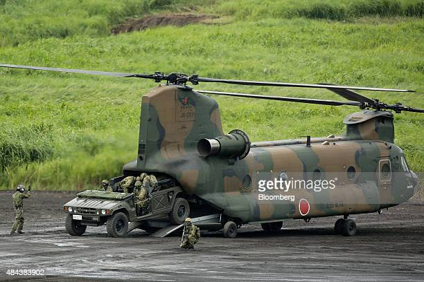 A Japan Ground SelfDefense Force high mobility vehicle drives out of a CH47 Chinook transport helicopter during a live fire exercise in the Hataoka...