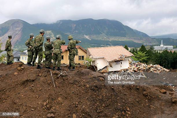 Japan Ground Self-Defense Force members check prior to the restart of the searching operation on April 22, 2016 in Minamiaso, Kumamoto, Japan....