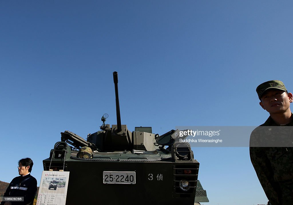 A Japan Ground Self-Defense Force (JGSDF) officer stands next to a tank during the military demonstration on November 25, 2012 in Himeji, Japan. The military exhibition and demonstration marks the 61-year anniversary of the Japan Ground Self-Defense Force based in Himeji.