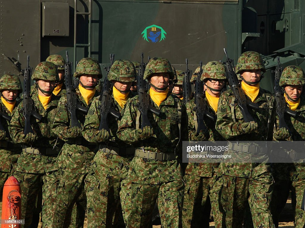 Japan Ground Self-Defense Force (JGSDF) officers march during the military demonstration on November 25, 2012 in Himeji, Japan. The military exhibition and demonstration marks the 61-year anniversary of the Japan Ground Self-Defense Force based in Himeji.