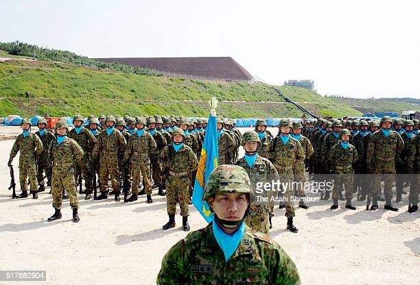 Japan Ground SelfDefense Force personnel attend the opening ceremony of the new base on March 28 2016 in Yonaguni Okinawa Japan 160 JGSDF members are...