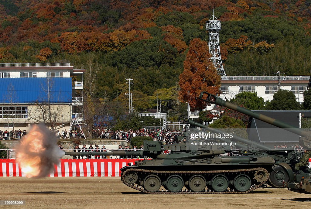 A Japan Ground Self-Defense Force (JGSDF) tank fires during the military demonstration on November 25, 2012 in Himeji, Japan. The military exhibition and demonstration marks the 61-year anniversary of the Japan Ground Self-Defense Force based in Himeji.