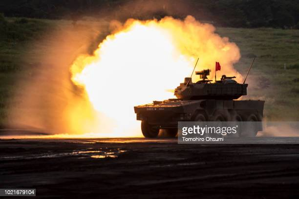 Japan Ground SelfDefense Force Type 16 maneuver combat vehicle fires ammunition during a live fire exercise at the foot of Mount Fuji in the Hataoka...