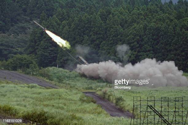 Japan Ground Self-Defense Force Type 92 mine-clearance vehicle launches a rocket during a live fire exercise in the Hataoka district of the East Fuji...