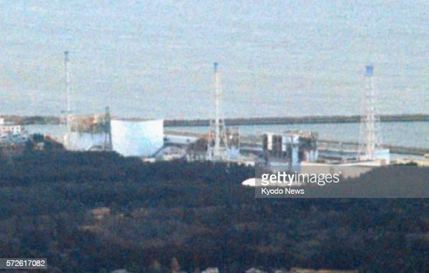 FUKUSHIMA Japan Handout photo shows the quakehit Fukushima Daiichi Nuclear Power Station in Fukushima Prefecture about 220 kilometers northeast of...