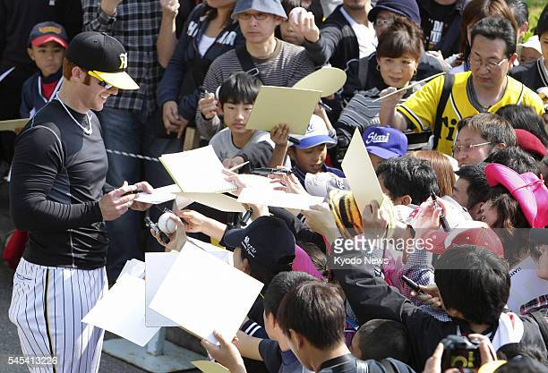 GINOZA Japan Hanshin Tigers outfielder Matt Murton of the United States signs autographs for fans at the baseball team's training camp in the village...