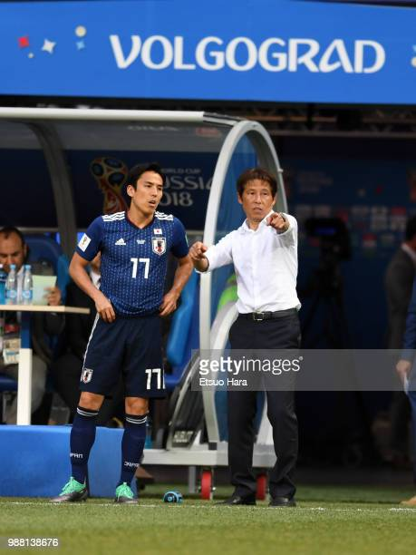 Japan head coach Akira Nishino gives instruction to Makoto Hasebe during the 2018 FIFA World Cup Russia group H match between Japan and Poland at...