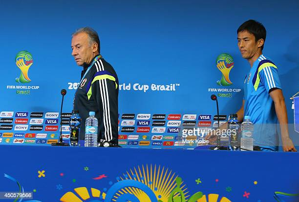 Japan head coach Alberto Zaccheron and captain Makoto Hasebe arrive for a press conference at Arena Pernambuco on June 13 2014 in Recife Pernambuco