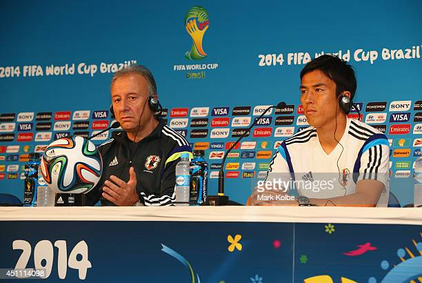 Japan head coach Alberto Zaccheroni and Japan captain Makoto Hasebe speak to the media during a Japan press conference at Arena Pantanal on June 23...