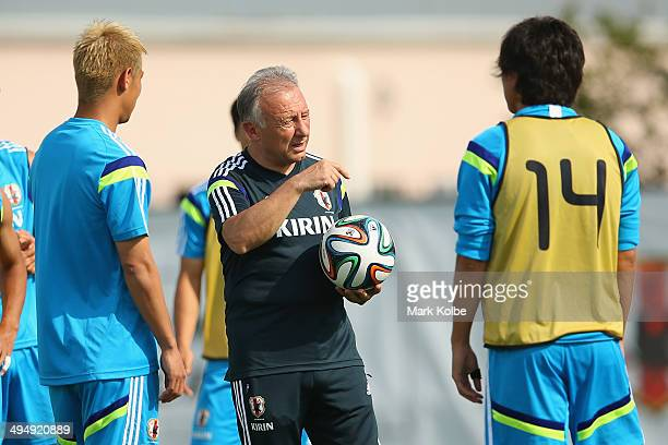 Japan head coach Alberto Zaccheroni explains the rules for a drill at a Japan training session at North Greenwood Recreation Aquatic Complex on May...