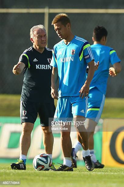 Japan head coach Alberto Zaccheroni speaks to Keisuke Honda during a Japan training session at the Japan national team base camp at the Spa Sport...