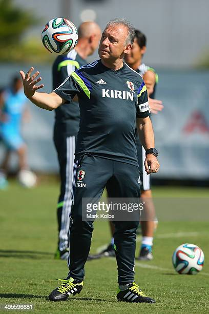Japan head coach Alberto Zaccheroni throws a ball during a Japan training session at North Greenwood Recreation Aquatic Complex on June 4 2014 in...