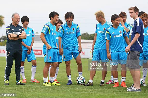 Japan head coach Alberto Zaccheroni watches on as Shinji Okazaki, Yasuhito Endo and Keisuke Honda share a joke as they pose for pictures with...