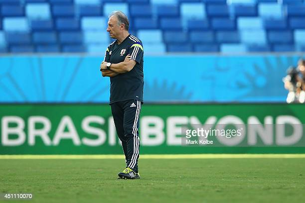 Japan head coach Alberto Zaccheroni watches on during a Japan training session at Arena Pantanal on June 23 2014 in Cuiaba Mato Grosso