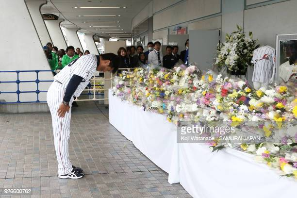 Japan head coach Atsunori Inaba offers a flower in commemoration for late Japan national team head coach Senichi Hoshino prior to during the game one...