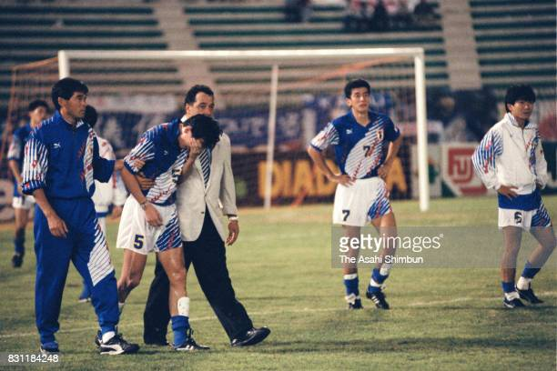 Japan head coach Hans Ooft consoles his players after the 1994 FIFA World Cup Asian Final Qualifier match between Japan and Iraq at AlAhly Stadium on...