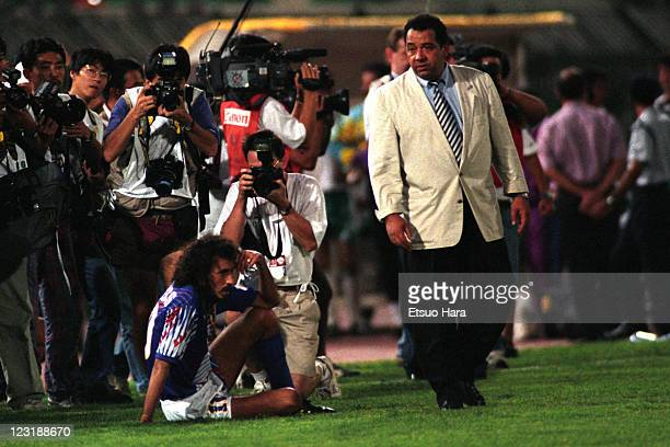 Japan head coach Hans Ooft consoles Ramos Ruy after the 1994 FIFA World Cup Asian Final Qualifier match between Japan and Iraq at AlAhly Stadium on...