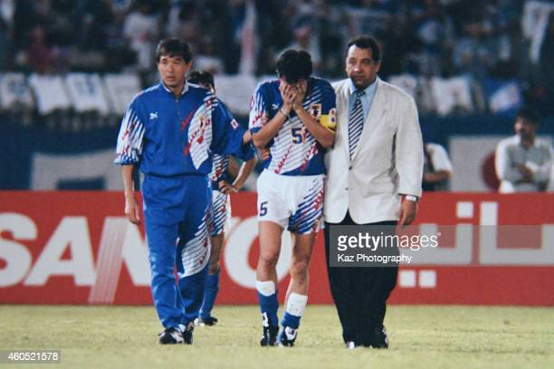Japan Head Coach Hans Oot and Coach Eijun Kiyokumo console Tetsuji Katsuratani of Japan on during the 1994 FIFA World Cup Asian Final Qualifier match...