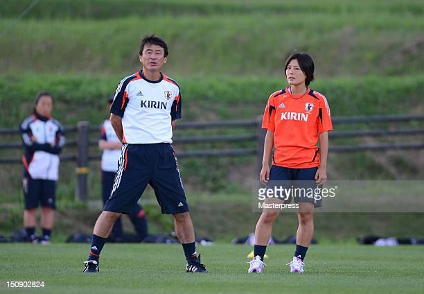 Japan head coach Hiroshi Yoshida and Hikaru Naomoto talk during the training session at Izumi Football Field on August 20 2012 in Sendai Japan